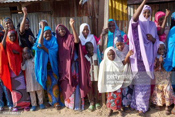 Crowd cheering the Emir of Gumel as he passed through the streets of the city during the celebration of a durbar A durbar is a celebration in...