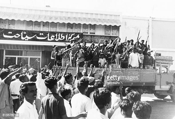 Crowd cheers a truckload of pro-independence Mukti Bahini guerrillas two days after the Pakistani surrender at the end of the Bangladesh War of...