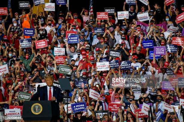 Crowd cheers for President Donald Trump as he arrives to make remarks during a rally at Gastonia Municipal Airport on October 21, 2020 in Gastonia,...