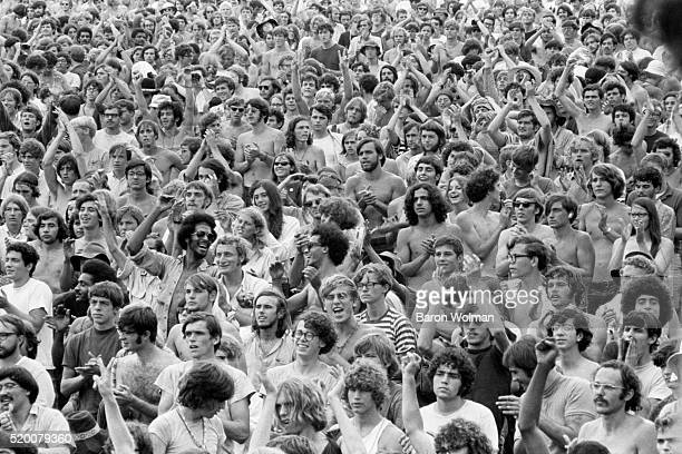 A crowd clap their hands at the Woodstock Music Art Fair Bethel NY August 15 1969