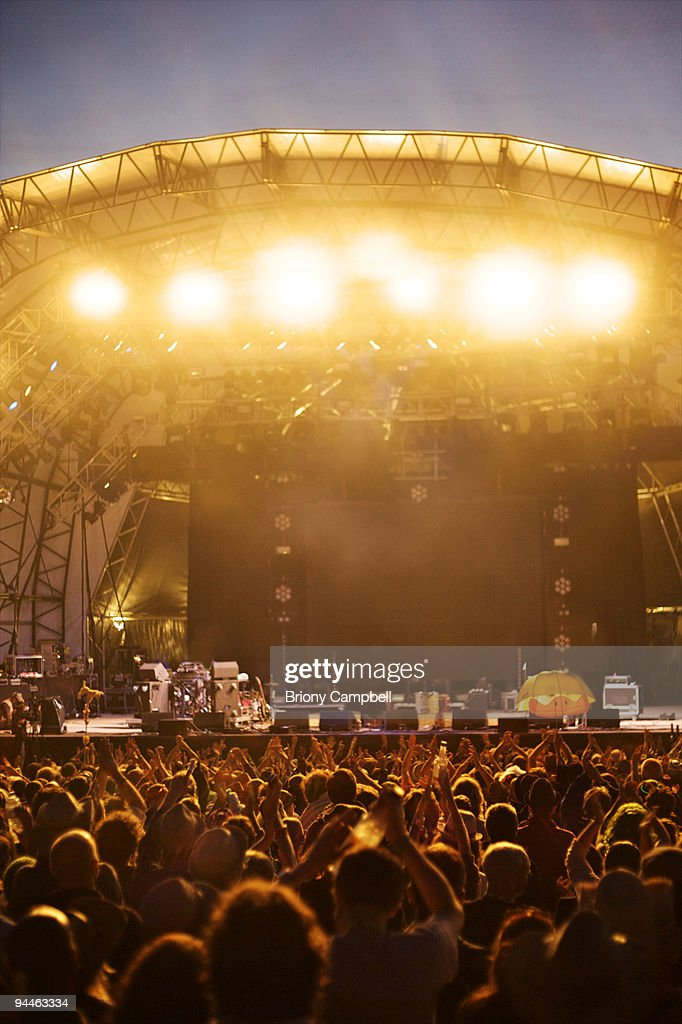 crowd clapping at empty stage : Stock Photo