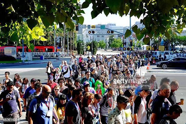 A crowd crosses the street in front of the San Diego Convention Center as fans head in for the first day of the 45th annual San Diego ComicCon on...