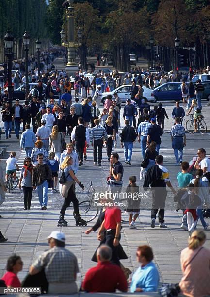 Crowd crossing street, blurred.