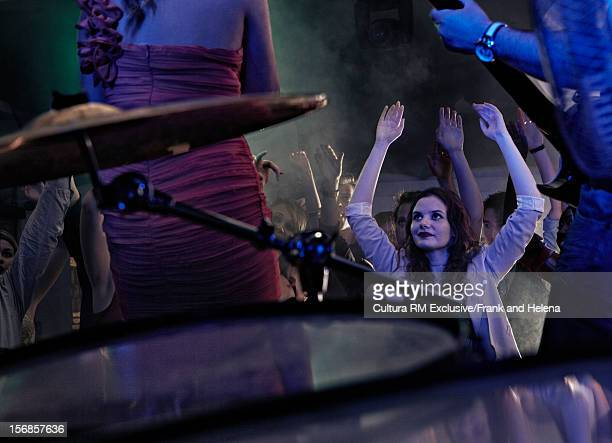 crowd dancing to band in club - performance group stock pictures, royalty-free photos & images