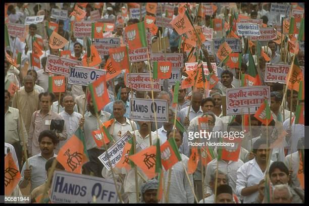 Crowd during Bharatiya Janata Party antiPakistan proIndia rally replete w Hindu nationalist BJP flags hands off Pakistan fr Kashmir signs
