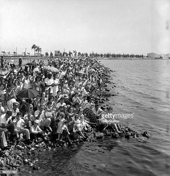 Crowd during the launching of a boat by Fidel Castro in Matanzas about 1960