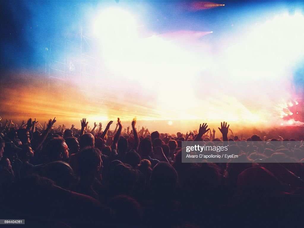 Crowd Enjoying Illuminated Music Concert At Night : Stock Photo