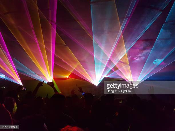 crowd enjoying music concert at night - lighting equipment stock pictures, royalty-free photos & images