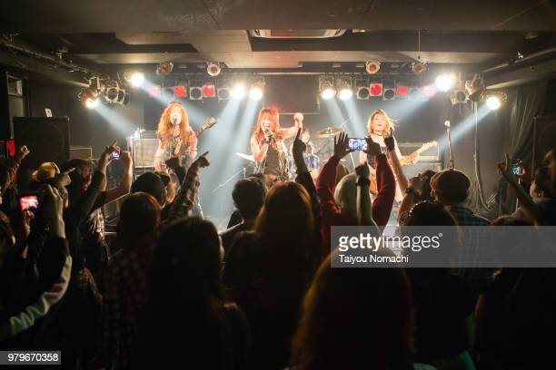A crowd enthusiastic about the performance of female rock bands