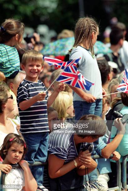 A crowd filled with children watch the celebrations during the Queen Mother's 100th birthday along the Mall in London
