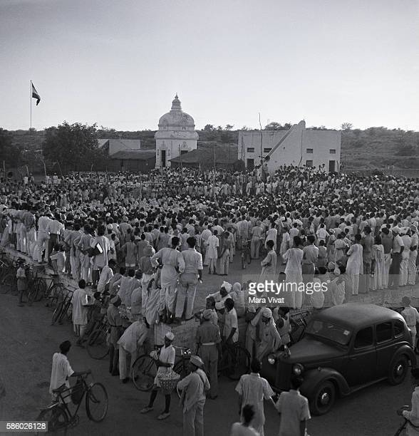 A crowd fills a public square in an Indian town for a speech by Mohandas Gandhi India