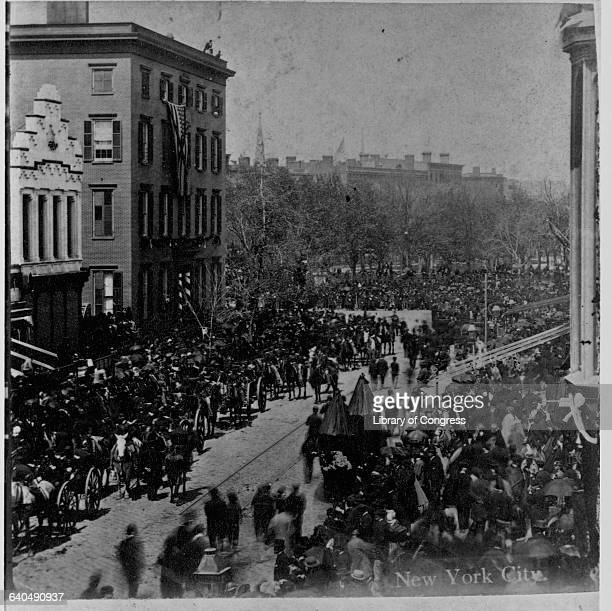 A crowd fills Union Square for the funeral of President Lincoln as the procession enters the square