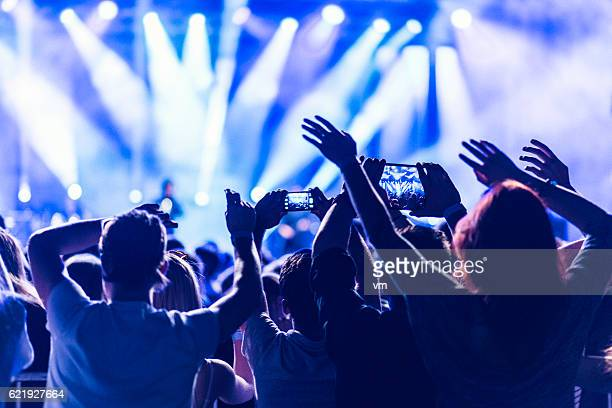 Crowd filming a concert with their smartphones