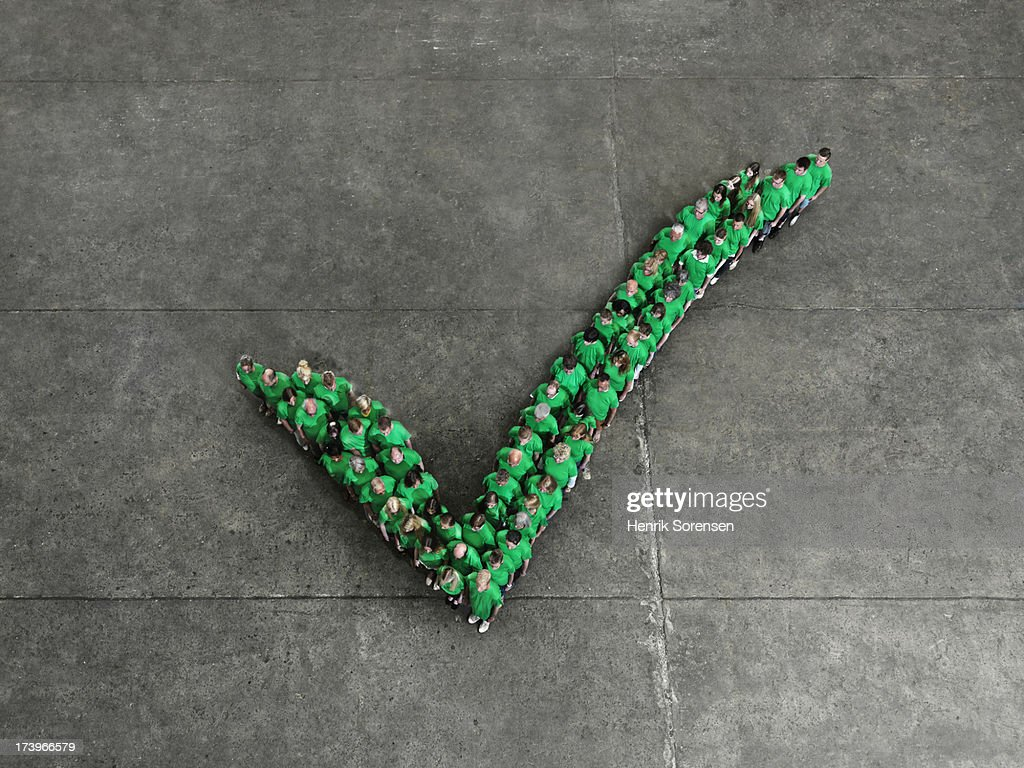Crowd forming a check mark : Stock Photo