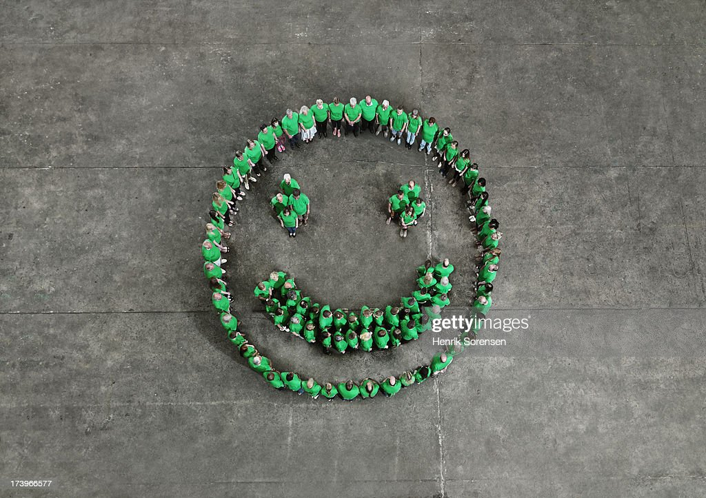 Crowd forming a happy smiley : Stock Photo