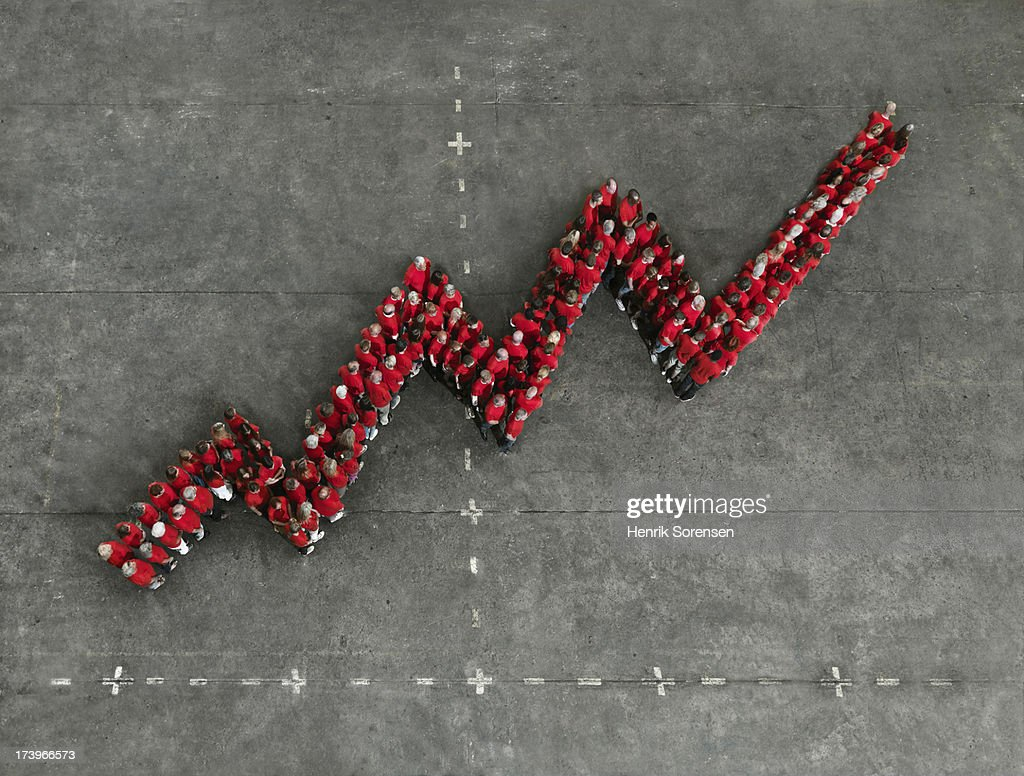 Crowd forming a positve graph : Stock Photo