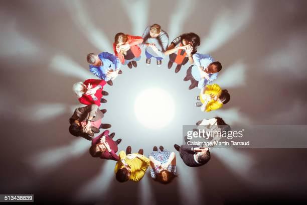 Crowd forming circle around bright light