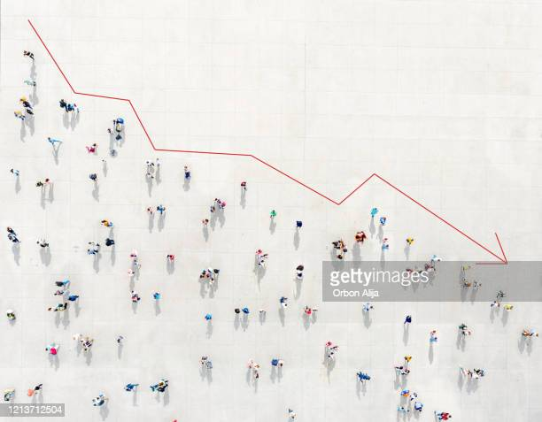 crowd from above forming a falling chart - economy stock pictures, royalty-free photos & images