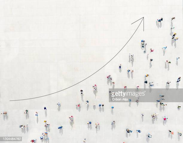 crowd from above forming a growth graph - moving up stock pictures, royalty-free photos & images