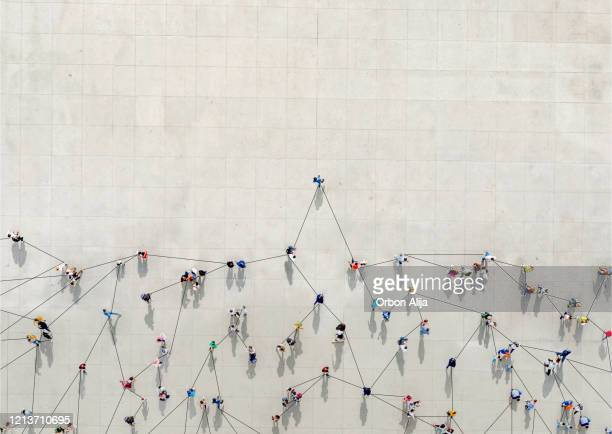 crowd from above forming a growth graph - large group of people imagens e fotografias de stock