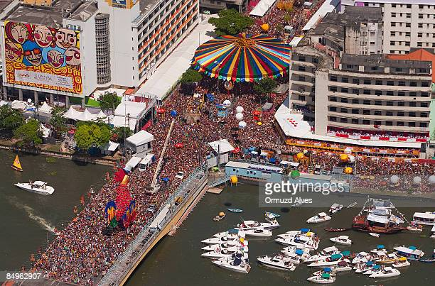 A crowd gather around a giant cock during the celebration of carnival on February 21 2009 in central Recife Brazil Certified by the Guinness Book of...