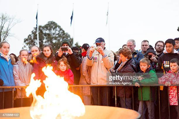 Crowd gather in front of the Eternal Flame during the Anzac Day dawn service at the Melbourne Shrine of Remembrance in Melbourne Victoria Australia...