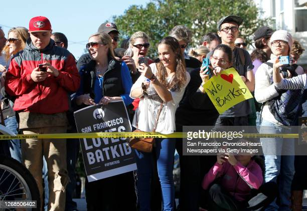 Crowd gather to see five year old Miles as Batkid rescue a damsel in distress along the Hyde Street cable car line in San Francisco Ca., on Friday...