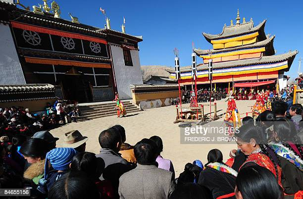 A crowd gather to watch Cham Dances at ongoing festivities celebrating Monlam or the Great Prayer Festival at the Gomar Gompa in Repkong on February...