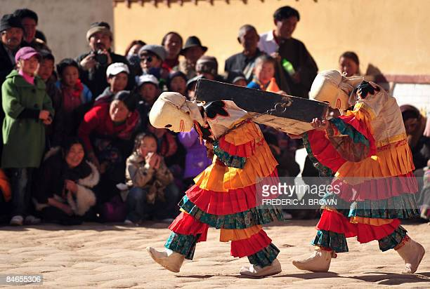 A crowd gather to watch Cham Dances during ongoing festivities celebrating Monlam or the Great Prayer Festival at a temple in Repkong on February 5...