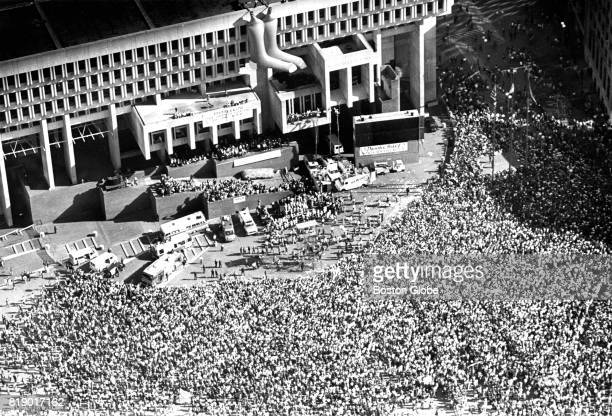 A crowd gathers around City Hall Plaza in Boston for a ceremony honoring the American League championship season of the Boston Red Sox on Oct 29 1986