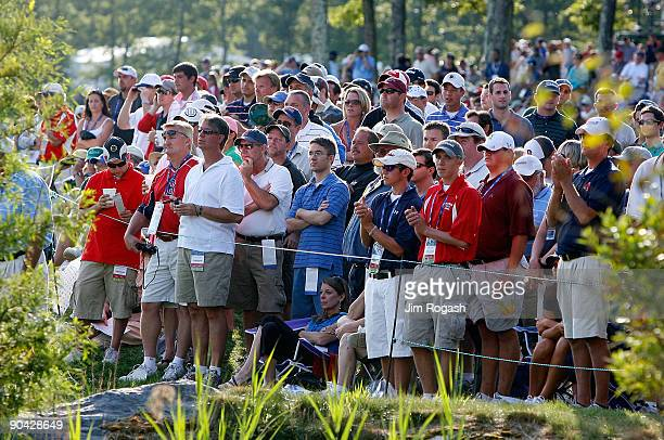 Crowd gathers around the 18th green during the final round of the Deutsche Bank Championship held at TPC Boston on September 7, 2009 in Norton,...