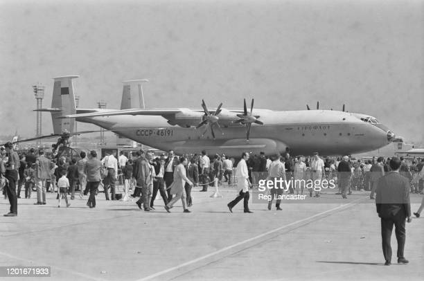 Crowd gathers around the prototype of an Antonov An-22, a heavy military transport aircraft making its debut at the 1965 Paris Air Show, held at Le...