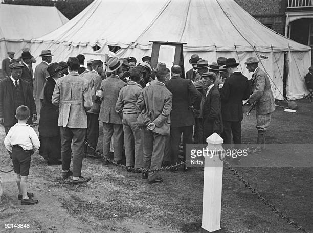 Crowd gathers around the scoreboard during the Open Golf Championship at the Royal Liverpool Golf Club in Hoylake, June 1924.