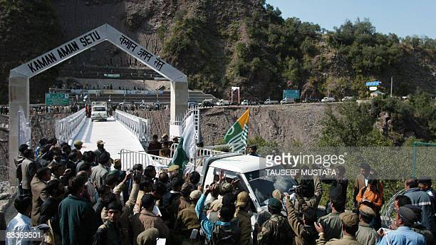 A crowd gathers as the first trucks carrying goods from Pakistaniadministered Kashmir enters the Indianadministered part of the Himalayan state as it...