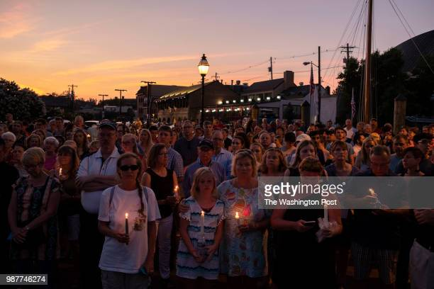 A crowd gathers at the City Dock for a vigil held in downtown Annapolis Maryland to honor the lives lost in yesterday's mass shooting during which...