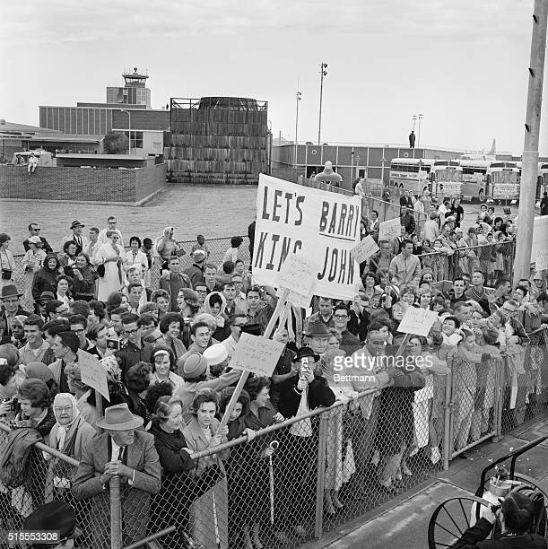 A crowd gathers at the Dallas Love Airport to greet President John F Kennedy