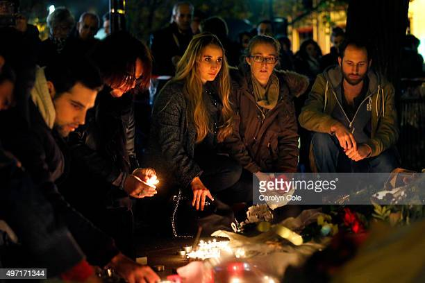 A crowd gathers at the Le Bataclan theatre to pay tribute and lay flowers for those who died in the terrorist attacks yesterday November 14 2015 in...