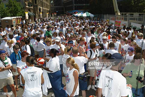 A crowd gathers during the Fourth Annual Lynx Basketball Dribble that benefits Breast Cancer Research on August 11 2002 at the Target Center in...