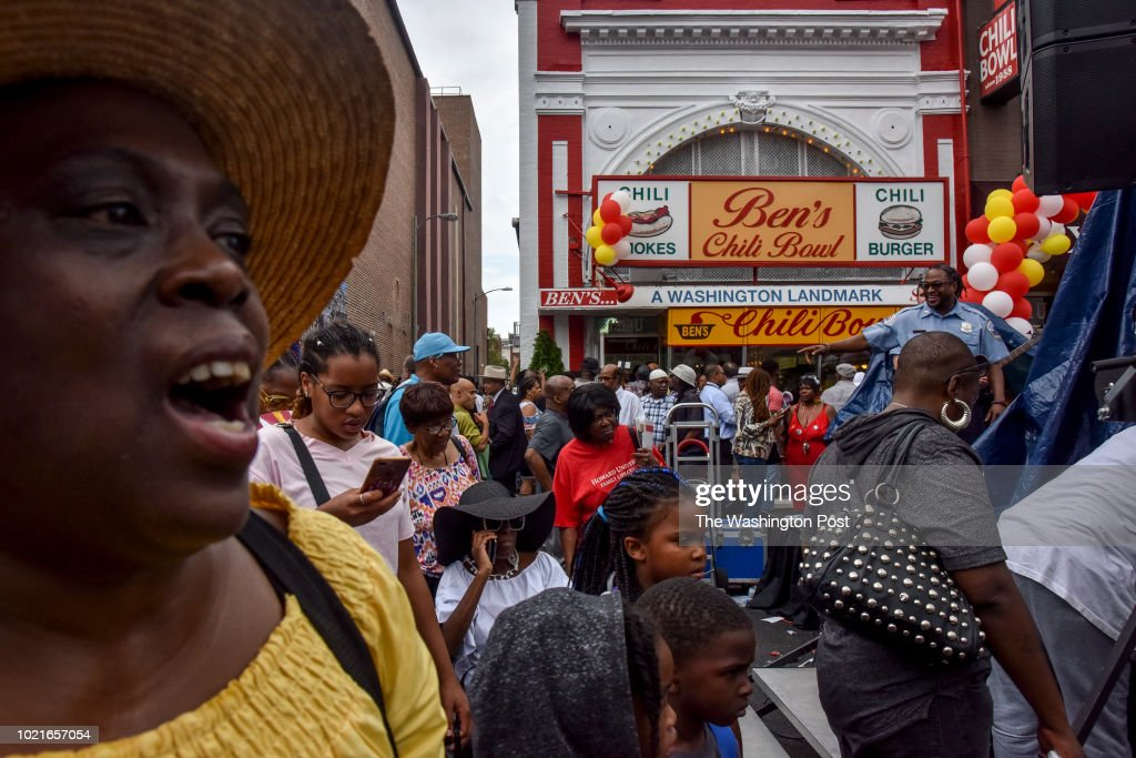 A crowd gathers for the 60th anniversary celebration of Ben's Chili Bowl on Wednesday, August 22, 2018, in Washington, DC. This U Street institution, which opened in 1958, has survived the 1968 riots and its neighborhood's rapid gentrification.