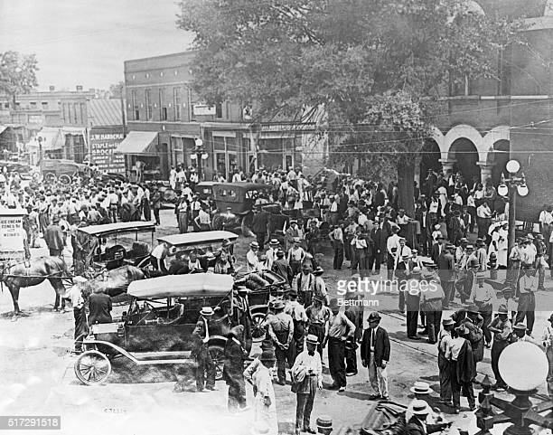 A crowd gathers in the town square of Marietta Georgia to discuss the lynching of Leo M Frank