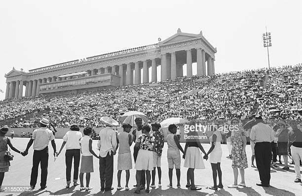 A crowd gathers inside Soldier Field during a freedom rally billed as a massive workshop in nonviolence Martin Luther King James Meredith and CORE's...
