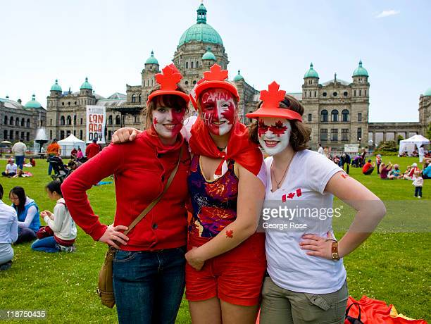 A crowd gathers on the Parliament lawn in anticipation of Canada Day festivities on July 1 2011 in Victoria British Columbia Canada The Canadian...
