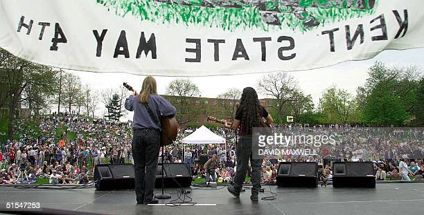 A crowd gathers on the University Commons as musicians perform at the beginning of a ceremony 04 May 2000 to mark the 30th anniversary of the 04 May...