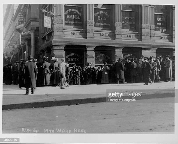 A crowd gathers outside of the Nineteenth Ward Bank as people run on the bank ca 19071914 New York City