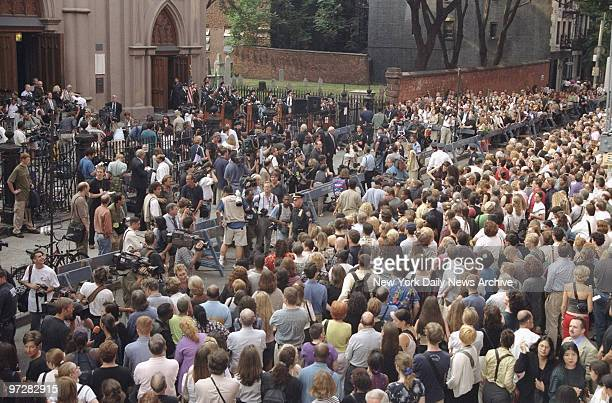 Crowd gathers outside Old St Patrick's Cathedral during memorial service for John F Kennedy Jr his wife Carolyn Bessette Kennedy and her sister...