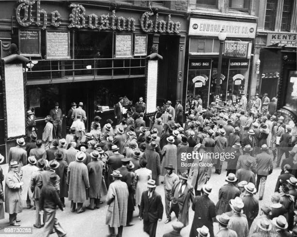 A crowd gathers outside The Boston Globe bulletin board displaying election results in Boston Nov 1940
