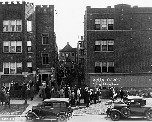 A crowd gathers outside the home of the murdered head of Unione Siciliana Joseph Aiello on Kolmer Avenue Chicago 1930 Aiello was murdered at the...
