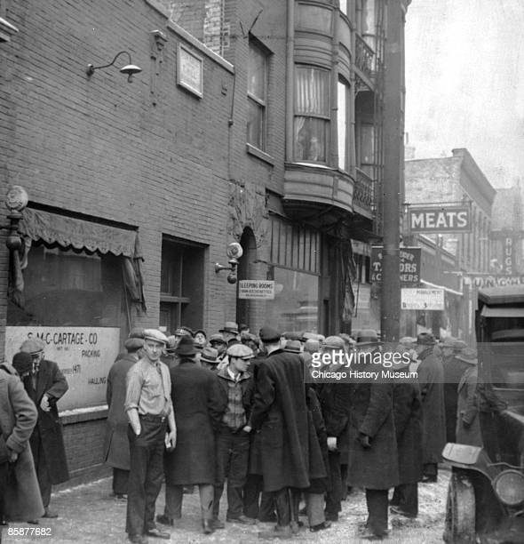 A crowd gathers outside the scene of the St Valentine's Day Massacre Chicago February 1929