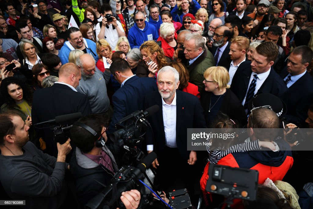 Crowd gathers round the leader of the Labour Party Jeremy Corbyn as he attends a campaign rally in Beaumont Park after launching the Labour Party Election Manifesto on May 16, 2017 in Huddersfield, England. Britain will vote in a general election on June 8.