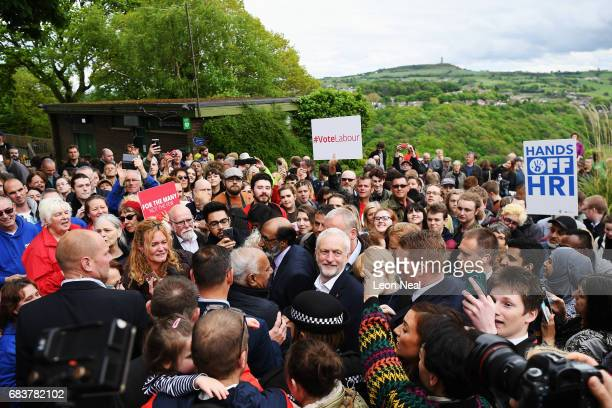 Crowd gathers round the leader of the Labour Party Jeremy Corbyn as he attends a campaign rally in Beaumont Park after launching the Labour Party...